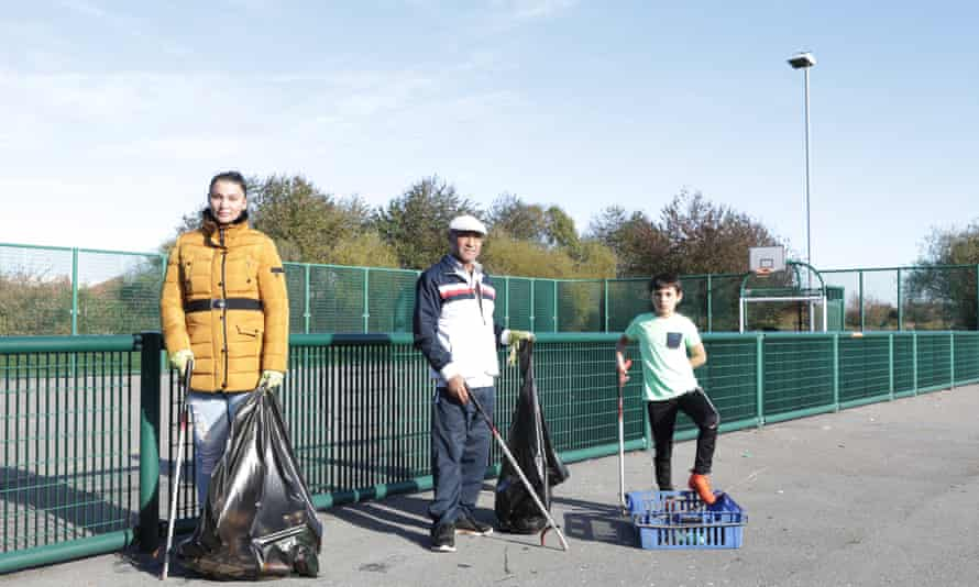 Three Roma – Miroslava, Naci and Jurej Nacko – help collect litter from the park in Eastwood, Rotherham.