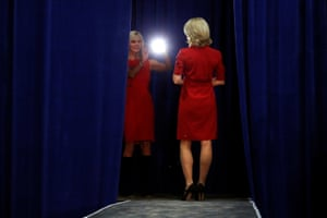 Two women take pictures in the wings before Republican presidential nominee Donald Trump attends a campaign event in Springfield, Ohio
