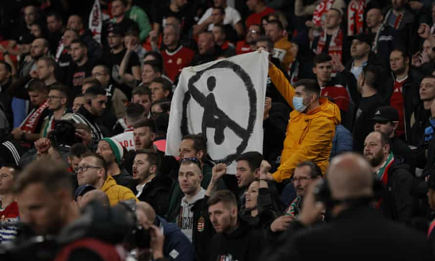 Hungary fans hold up a banner in protest against England players taking the knee, a gesture against all forms of discrimination.