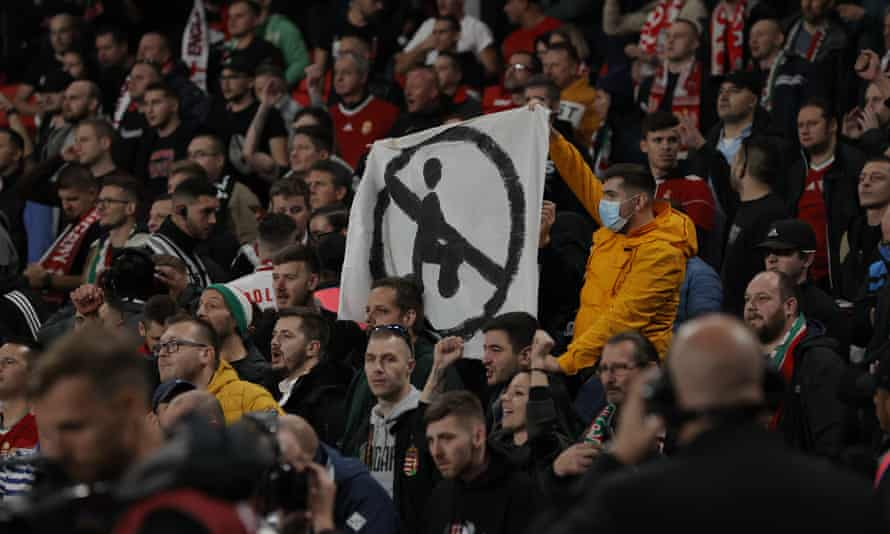 Hungary fans hold up an anti-kneeling banner during the 2022 World Cup qualifier at Wembley.