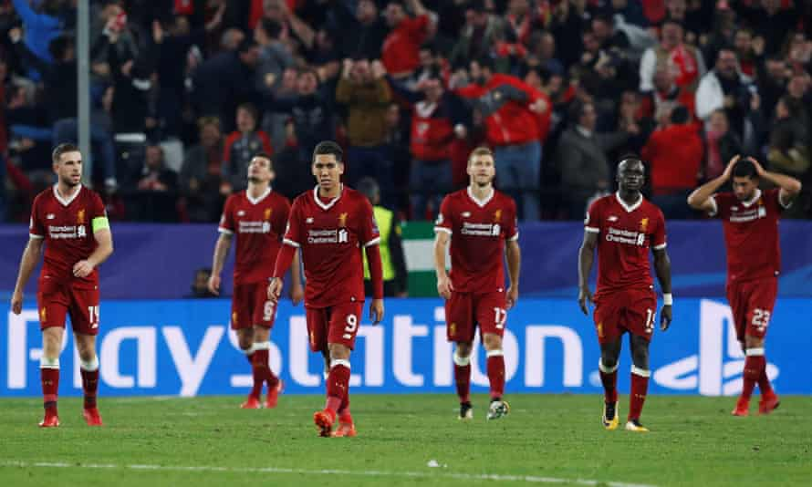 Liverpool players are left dejected after they let slip a three-goal lead with Sevilla equalising in added time.