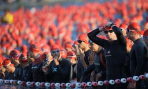 Athletes wait for the start of the swimming section of the Ironman triathlon in Frankfurt, Germany.