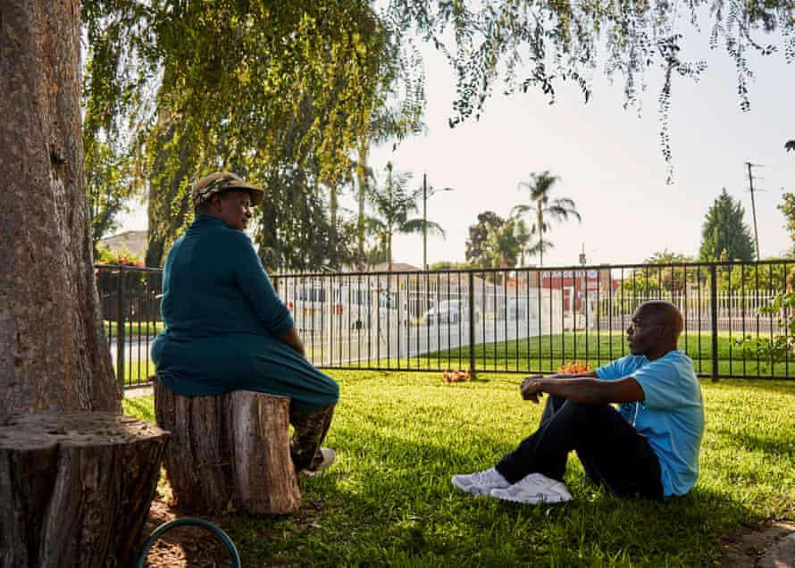 Thompson speaks with his friend of over 19 years, Gwendolyn Haynes, 70, at her home in Compton, California.