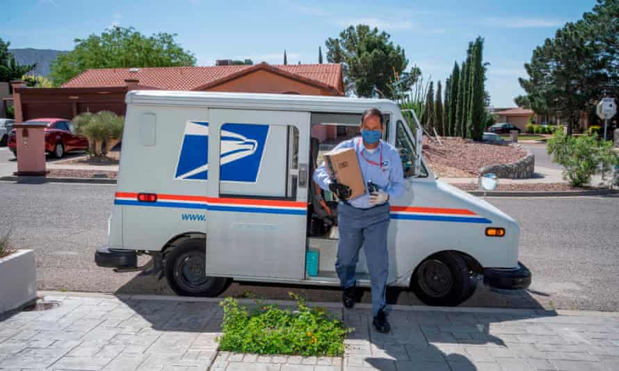 A US Postal Service worker makes his deliveries in El Paso, Texas. Working for the USPS means a stale job that pays a living wage – a rare thing in modern America.