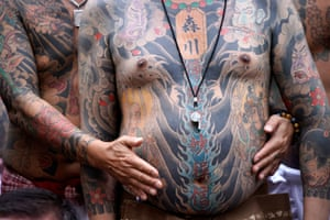 Sanja Matsuri festivalgoers in Tokyo show their traditional Japanese tattoos
