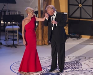 Donald Trump kisses the hand of his campaign manager Kellyanne Conway at a 'Candlelight' dinner to thank donors in Washington DC.