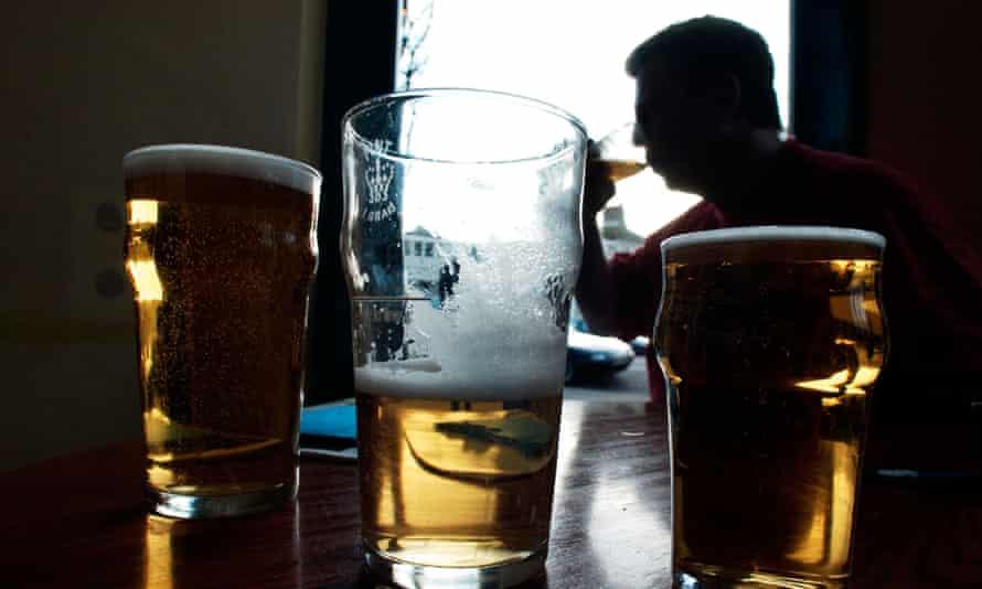 Man drinking in pub