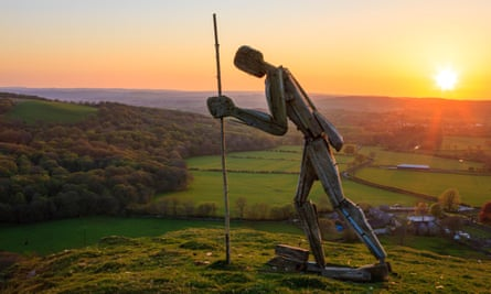 Pilgrim statue on the hilltop at Strata Florida Abbey, Ceredigion at sunset