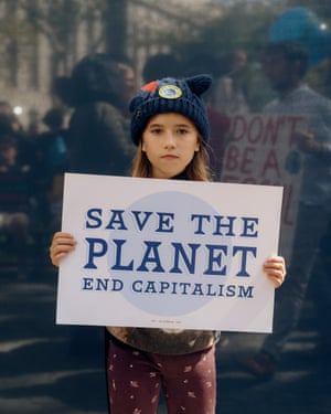 """Seren Roberts, 10, poses for a portrait at the Climate Strike NYC protest, part of a worldwide day of protests to bring attention to climate change. What scares you most about climate change? """"It's that people and animals will get hurt if we don't make a change. And trees will start dying and we need the air."""" Why are you marching? """"Because I don't want anyone to get hurt."""""""
