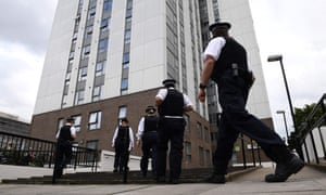 Police officers arrive at a tower block in north London from which residents are being evacuated due to fire safety fears.