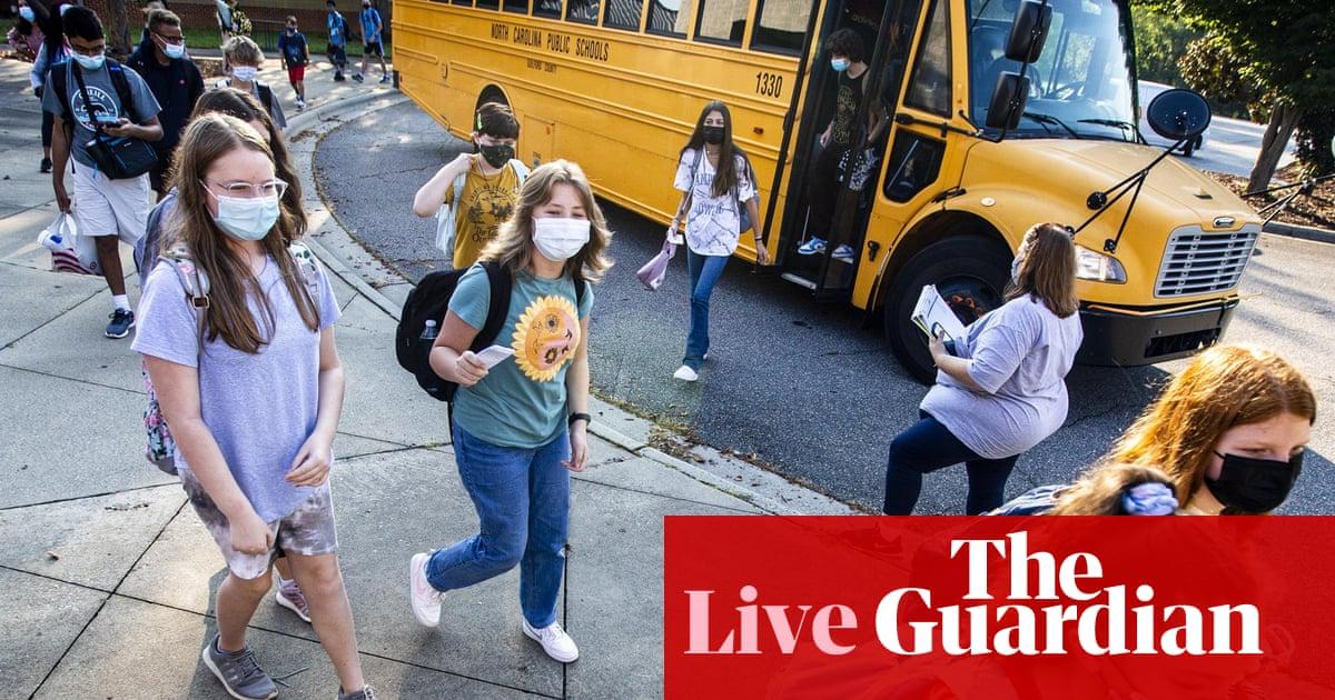 US school students return amid threat of Delta disruption – live