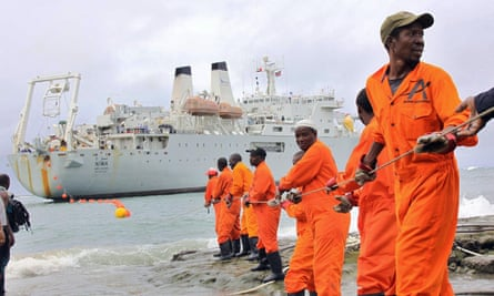 Workers haul part of a fibre optic cable on to the shore at Mombasa, Kenya. 'Research suggests many African countries are well placed to take advantage of a more open trading environment.'