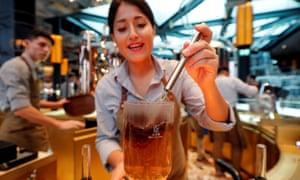 An employee prepares a coffee inside the Starbucks in Milan.