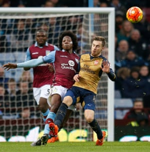 Aston Villa's Carlos Sanchez, left, determined not to make it too easy for Arsenal.