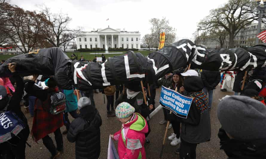Indigenous leaders protest against the Dakota Access and Keystone XL pipelines in front of the White House in March 2017