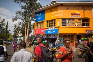 People go about their business in Kigali, Rwanda.