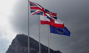 The union, Gibraltarian and EU flags at the border of Gibraltar with Spain.