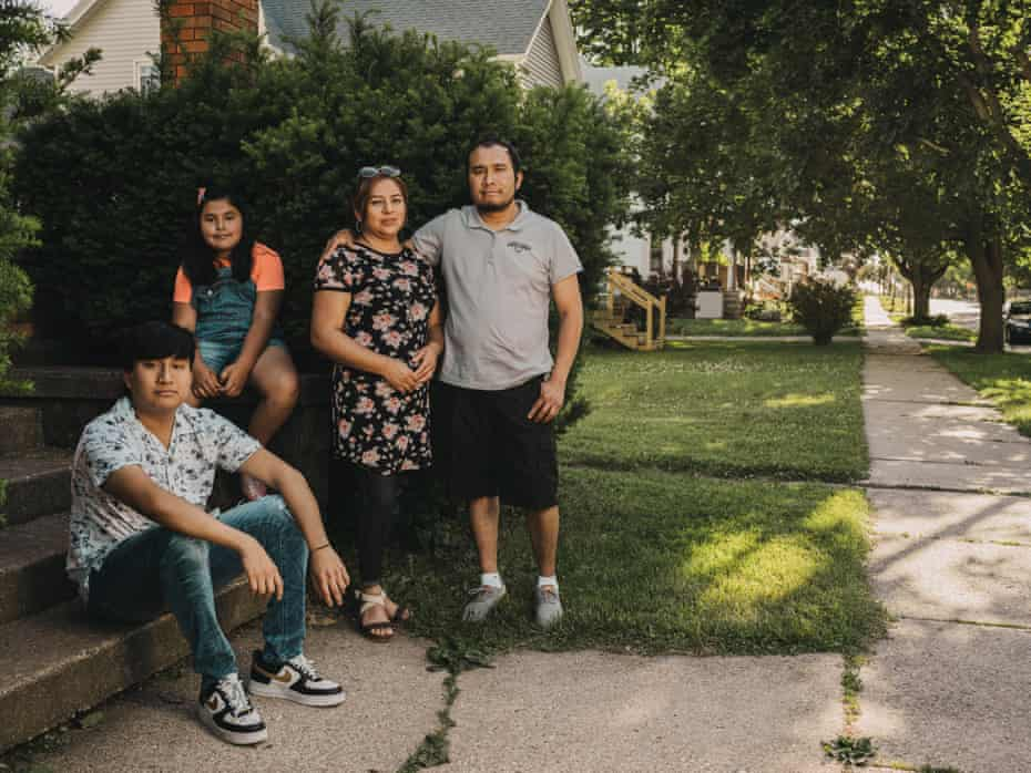 """Efren """"Freddy"""" Herrera stands with his wife Susana, and children Freddy, 15, and Zoe, 8 at their home in Monroe, Wisconsin. Herrera immigrated from Mexico when he was 14."""