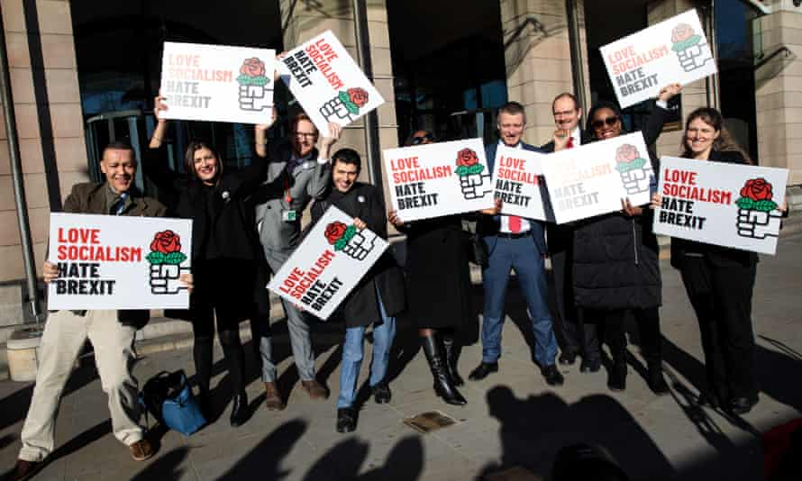 Labour MPs hold placards as they demonstrate against Brexit during a photo opportunity outside MPs' offices at Portcullis House in London on 5 March