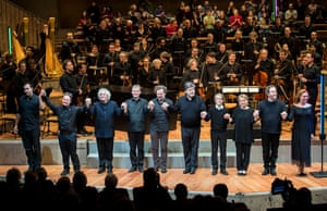 Peter Sellars and Simon Rattle (second and third from left) take the applause with soloists after a performance with the Berliner Philharmoniker.