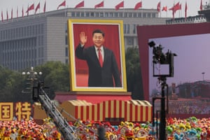 A float with a giant portrait of the Chinese president, Xi Jinping, passes by Tiananmen Square