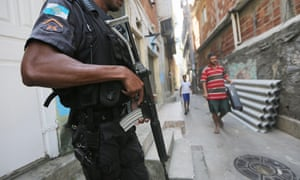 A UPP (Pacifying Police Unit) officer patrols in the Babilonia favela