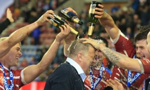 Wigan's head coach Shaun Wane is showered with champagne after his team defeated Cronulla Sharks in the 2017 World Club Series match at the DW Stadium.
