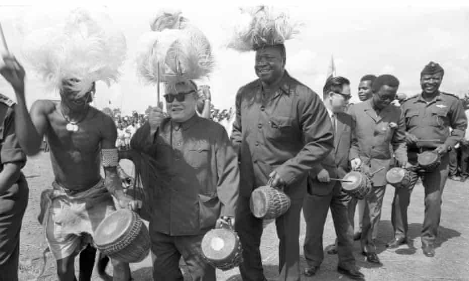 Idi Amin and guests celebrate 'Refugee Day' in 1975.