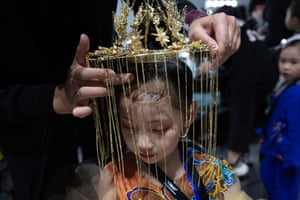 Beijing, China Child model Chen Ruoxi has a head dress fitted backstage before the Van Monfe show during the China Fashion Week. It is just one of 35 shows dedicated to children's fashion during the week