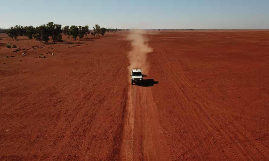 A grazier drives across his drought-affected property.