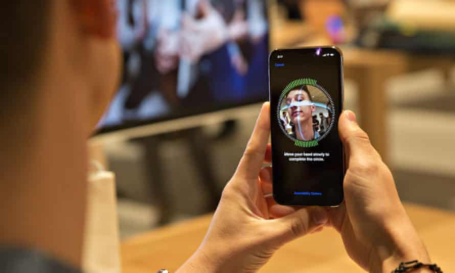 A customer sets up facial recognition on an Apple Inc. iPhone X