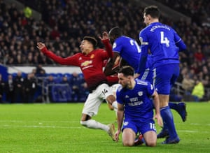 Cardiff City's Sol Bamba concedes a penalty against Manchester United's Jesse Lingard.