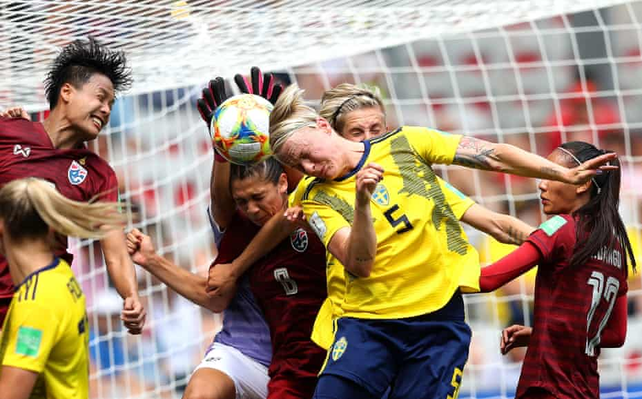 Nilla Fischer of Sweden competes for a header with Waraporn Boonsing and Miranda Nild of Thailand during a group F match between Sweden and Thailand at Stade de Nice.