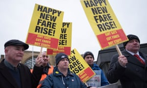 Campaigners protest against rail fare increases outside King's Cross station in London.