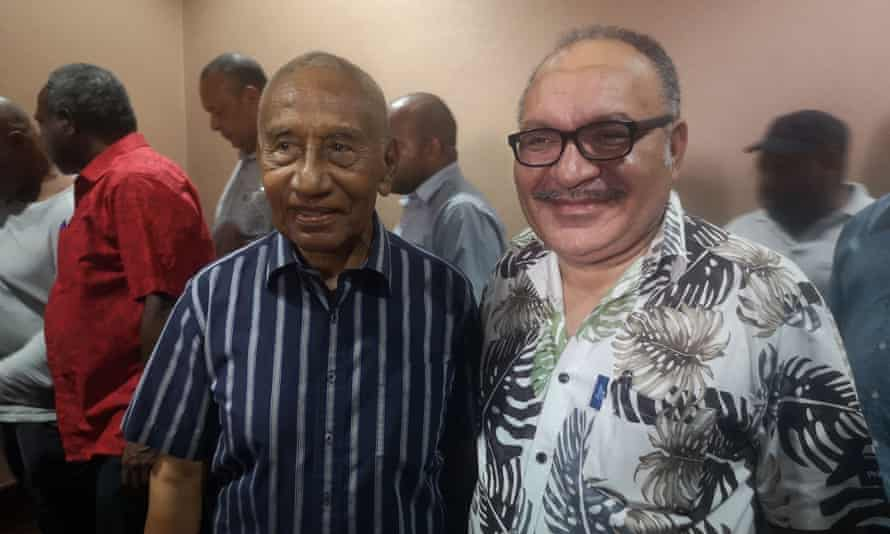 Peter O'Neill, right, resigned as prime minister of Papua New Guinea and plans to hand power to Sir Julius Chan, left. But the opposition says it will try to block his move.