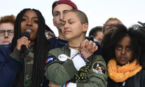 Emma González listens with other students during the March for Our Lives rally in Washington DC on 24 March.