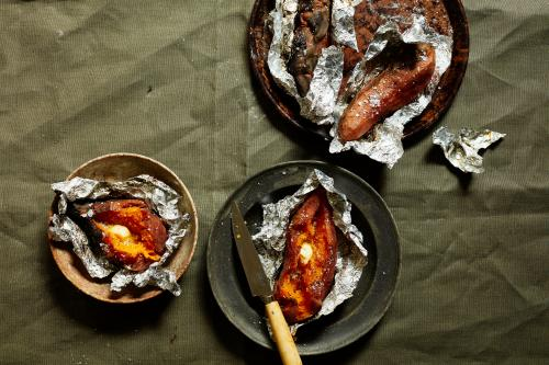 Ember-baked sweet potatoes just crying out for wads of melty butter.