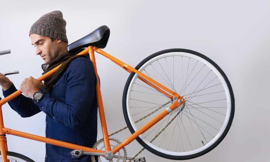 Man carrying bike