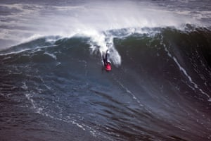 A bodyboarder rides a wave during a big-wave surfing session