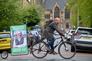 The Scottish Green party co convener, Patrick Harvie, poses for a picture after voting in Glasgow.