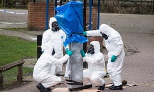 Forensics officers remove the bench where the former Russian spy Sergei Skripal and his daughter were found in Salisbury, England