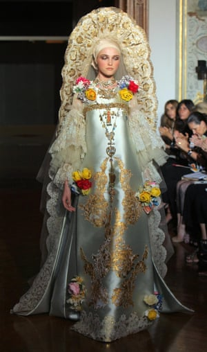 A model wearing an elaborate and ornate silver and gold gown and headdress by French designer Christian Lacroix during 2009/2010 Autumn-Winter Haute Couture collection show on July 7, 2009, in Paris