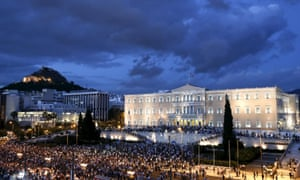 People gather in front of the Greek parliament during a rally calling on the government to clinch a deal with its international creditors and secure Greece's future in the Eurozone in Athens June 18, 2015.