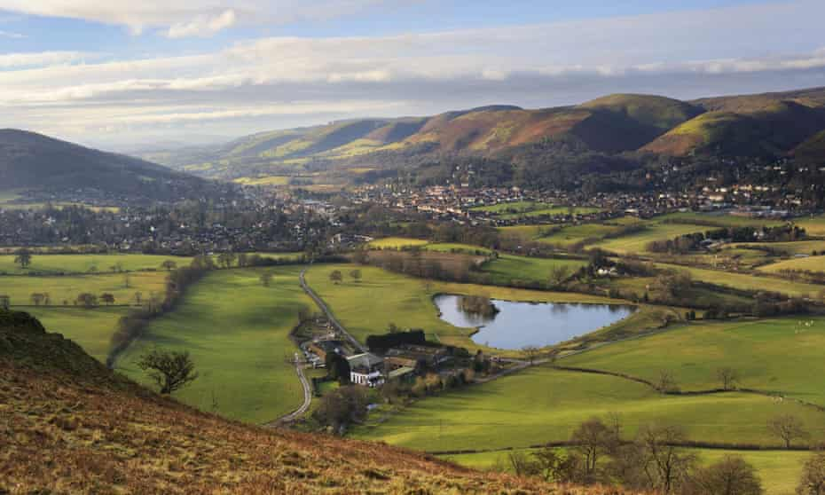 View of the town of Church Stretton and The Long Mynd hills from Caer Caradoc, Shropshire, UK.