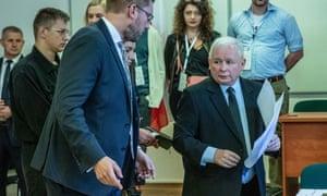 Jarosław Kaczyński (right) president of the Law and Justice party, votes in Warsaw