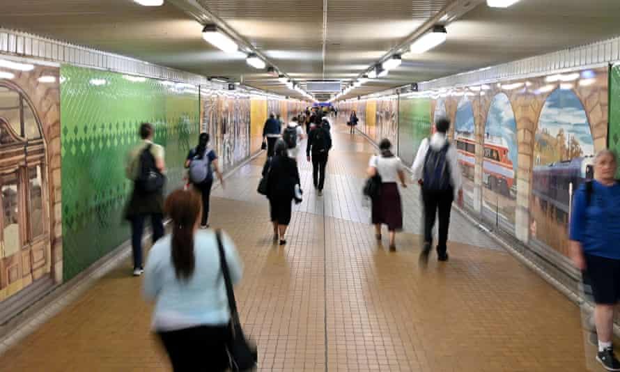 Pedestrians pass through Central Station in Sydney, March 24, 2020.