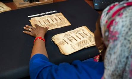 A restoration expert with one of the manuscripts in 2016.