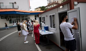 People wait in line to be tested for COVID-19 at Pirogov hospital in Sofia, Bulgaria.