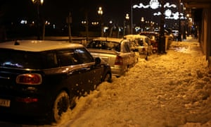 Sea foam covers the streets in Bayona, Galicia.