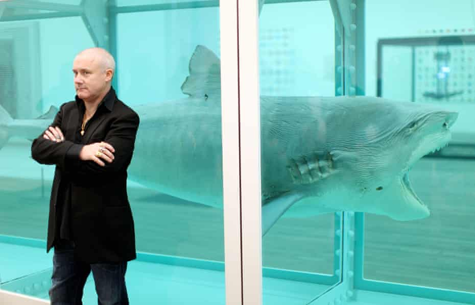 Damien Hirst beside his 1991 piece The Physical Impossibility of Death in the Mind of Someone Living.
